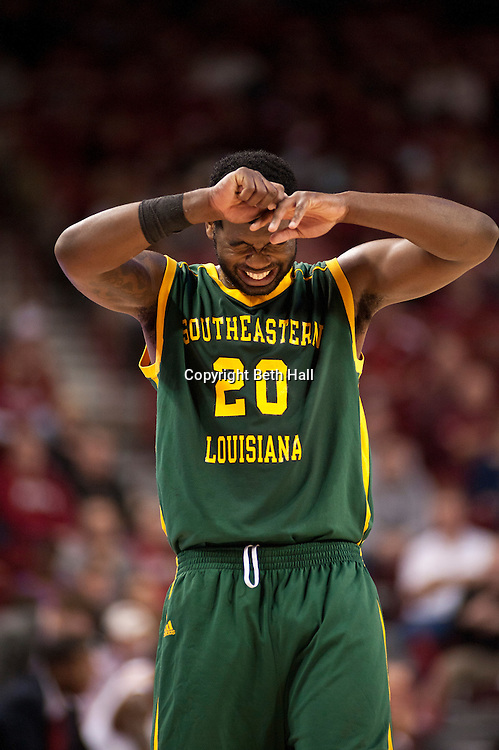 Dec 17, 2011; Fayetteville, AR, USA; Southeastern Louisiana Lions guard DeShawn Patterson (20) reacts to an injury during a game against the Arkansas Razorbacks at Bud Walton Arena. Arkansas defeated Southeastern Louisiana 62-55. Mandatory Credit: Beth Hall-US PRESSWIRE
