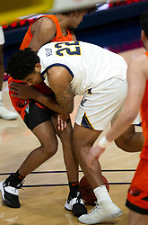 Feb 25, 2021; Berkeley, California, USA; California Golden Bears forward Andre Kelly (22) loses the ball as he collides with Oregon State Beavers guard Ethan Thompson during the first half of an NCAA college basketball game at Haas Pavilion. Mandatory Credit: D. Ross Cameron-USA TODAY Sports