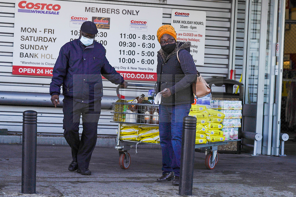 © Licensed to London News Pictures. 4/11/2020. Leeds, UK.  Shoppers wearing a face mask push their trolley after shopping at Costco in Leeds, West Yorkshire. British Prime Minister Boris Johnson announced a new four week lockdown across England, from Thursday 5 November, to contain the spread of covid-19.  Photo credit: Ioannis Alexopoulos/LNP