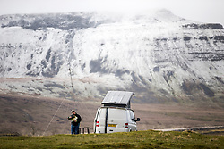 © Licensed to London News Pictures. 16/04/2016. Ribblehead UK. Picture shows camper's undeterred by the cold weather in the shadow of Pen-y-Ghent mountain this morning after last night's snow fall. Photo credit: Andrew McCaren/LNP