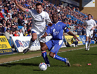 Photo: Olly Greenwood.<br />Gillingham v Huddersfield Town. Coca Cola League 1. 08/04/2006. Huddersfield's Pawel Abbott tries to get past Gillingham's Ian Cox.