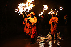 © Licensed to London News Pictures. 06/02/2016. Marsden, UK.Hooded druids carry torches as they lead the procession during the spectacular Imbolc fire festival in Marsden, West Yorkshire, UK. Based on ancient pagan traditions,  Imbolc is a Gaelic festival celebrating the end of winter and the coming of spring. The focal point of the event is the face-off between the Green Man, who represents the coming spring, and Jack Frost, winter - with the former coming out on top. Photo credit : Ian Hinchliffe/LNP