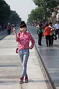 Tourists on Qianmen Da Lu near Tiananmen just south of Tiananmen in Beijing, China.
