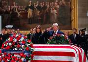 U.S. President Donald Trump salutes the casket for former U.S. President George H.W. Bush inside the U.S. Capitol rotunda in Washington, U.S.  REUTERS/Jim Young
