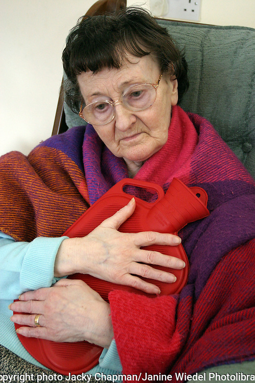 Older woman with dementia hugging hot water bottle