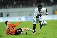 FOOTBALL - FRENCH CHAMPIONSHIP 2009/2010 - L1 - FC LORIENT v OLYMPIQUE LYONNAIS - 20/01/2010 - PHOTO PASCAL ALLEE / DPPI - BAFETIMBI GOMIS (OL) / LAURENT KOSCIELNY (LORIENT)