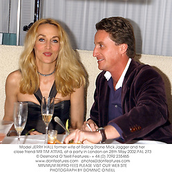 Model JERRY HALL former wife of Rolling Stone Mick Jagger and her close friend MR TIM ATTIAS, at a party in London on 28th May 2002.PAL 273