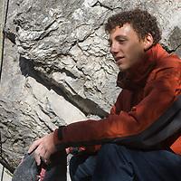 Rock climber Eric Sethna relaxes at Rundle Rock near Banff, Alberta, in Canada's Banff National Park.