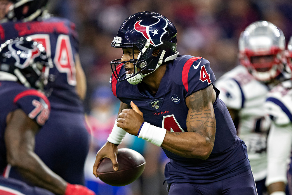 HOUSTON, TX - DECEMBER 1:  Deshaun Watson #4 of the Houston Texans runs the ball during the first half of a game against the New England Patriots at NRG Stadium on December 1, 2019 in Houston, Texas.  The Texans defeated the Patriots 28-22.  (Photo by Wesley Hitt/Getty Images) *** Local Caption *** Deshaun Watson