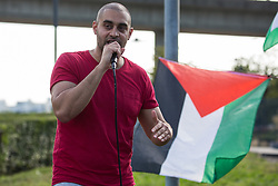 Rapper Lowkey addresses human rights activists outside ExCeL London as preparations take place for the DSEI 2021 arms fair on 6th September 2021 in London, United Kingdom. The first day of week-long Stop The Arms Fair protests outside the venue for one of the world's largest arms fairs was hosted by activists calling for a ban on UK arms exports to Israel.