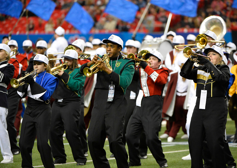 A guest band section performs in the first half of the Ole Miss vs. TCU Chick-fil-A Peach Bowl football game at the Georgia Dome on December 31, 2014. David Tulis / Abell Images for the Chick-fil-A Bowl