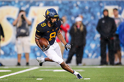 Sep 8, 2018; Morgantown, WV, USA; West Virginia Mountaineers wide receiver Marcus Simms (8) returns a kickoff during the second quarter against the Youngstown State Penguins at Mountaineer Field at Milan Puskar Stadium. Mandatory Credit: Ben Queen-USA TODAY Sports