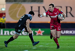 Scarlets' Hadleigh Parkes hands off Toulon's Anthony Belleau<br /> <br /> Photographer Simon King/Replay Images<br /> <br /> European Rugby Champions Cup Round 6 - Scarlets v Toulon - Saturday 20th January 2018 - Parc Y Scarlets - Llanelli<br /> <br /> World Copyright © Replay Images . All rights reserved. info@replayimages.co.uk - http://replayimages.co.uk