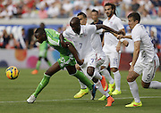 JACKSONVILLE, FL - JUNE 07:  Defender DaMarcus Beasley #7 (center) and defender Matt Besler #5 (right) of the United States chase the ball behind forward Shola Ameobi #23 of Nigeria during the international friendly match at EverBank Field on June 7, 2014 in Jacksonville, Florida.  (Photo by Mike Zarrilli/Getty Images)