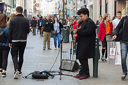 June 14, 2018 - Dublin, Ireland - Musician performing on a busy Grafton Street, in Dublin city center. (Credit Image: © Paulo Lopes via ZUMA Wire)