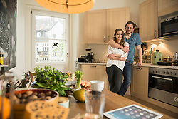 Man hugging his wife in the kitchen, Munich, Bavaria, Germany
