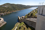 Barragem do Alqueva dam part of the multipurpose water management project on the Rio Guadiana river hydro-electricity generation electricity power lines