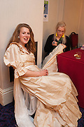 HARRIET RIX HAVING DRESS REPAIRED BY EMILY ROSE WETHERELL, The Royal Caledonian Ball 2013. The Great Room, Grosvenor House. Park lane. London. 3 May 2013.
