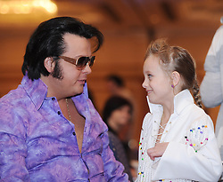 © Licensed to London News Pictures. 07/01/2012. BIRMINGHAM, UK.  Garry John and his daughter Sydney (8) take part in the annual European Elvis Championship at the Hilton Metropole Hotel at the National Exhibition Centre today.  Photo credit: Alison Baskerville/LNP