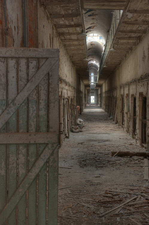 """Eastern State Penitentiary, Philadelphia, PA (US). HDR image. Opened in 1829, and dubbed the """"Pennsylvania System"""" or Separate system, originated and encouraged solitary confinement as a form of rehabilitation. The prison was closed and abandoned in 1971, now operates as a museum and historic site."""