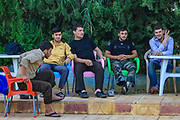 Members of the Free Syrian Army (FSA) take a moment for a brief break under the tree shed nearby a Swimming Pool on Wednesday, June 27, 2012. (Photo by Vudi Xhymshiti)