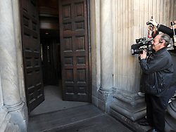 35559258© Licensed to London News Pictures. 28/10/2011. London, UK. Media watch the doors of the cathedral open. A Eucharist service held at St Paul's Cathedral today. St Paul's Cathedral reopened its doors at midday today. The Cathedral had been closed over health and safety fears from the Occupy London protest outside.  Photo: Stephen Simpson/LNP