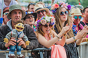 Fans young and older await Squeeze on the Pyramid stage - The 2016 Glastonbury Festival, Worthy Farm, Glastonbury.