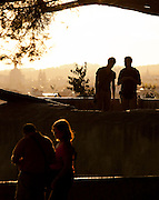 People gather to watch the sunset over Lisbon from the Castelo de Sao Jorge, Portugal