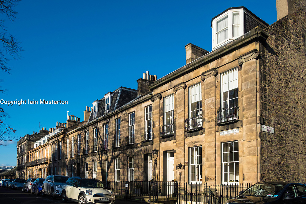 View of terraced townhouses on Saxe Coburg Place in Stockbridge district of New Town in Edinburgh , Scotland, United Kingdom