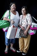 JAVIER CALVELO/  MONTEVIDEO/ TIPOS HUMANOS - Shopping Nuevo Centro<br /> Proyecto documental sobre la identidad, lo nacional, lo Uruguayo y el consumo. Se trata de retratos simples mirando a camara y con un fondo neutro. Les pregunto a los fotografiados como quieren ser recordados en el futuro, sus nombres y que hacen.<br /> El trabajo esta influenciado por la obra de August Sander pero tambien por Richard Avedon y Manuel Alvarez Bravo. <br /> El titulo esta basado en la obra de Raymond Firth, Tipos Humanos. (Raymond William Firth, ( 1901-2002) fue un etnólogo neozelandés profesor de Antropología en la London School of Economics, es uno de los fundadores de la antropología económica británica). <br /> En la foto:  Tipos Humanos en el Shopping Nuevo Centro.Carmen Pesciano y Adriana Fleitas. Foto: Javier Calvelo <br /> cajust@montevideo.com.uy<br /> 2013-12-20 dia viernes