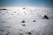Laufskálavarða is a lava ridge, surrounded by stone cairns, between the Hólmsá and Skálmá Rivers, close to the road north of Álftaver. Travellers crossing the desert of Mýrdalssandur for the first time would pile stones up to make a cairn, which was supposed to bring them good fortune on the journey.