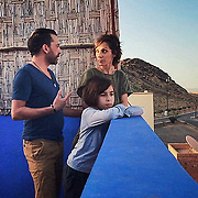"""""""We've been one lockdown since the 17 march in Marrakesh, downtown next the Mont Gueliz. We usually have very busy lifes and we took this experience in a positive way, sharing many new experiences togheter in joy and happiness. Jade is looking over the wall at his empty school, and does not really miss it :)""""<br /> <br /> """"Indeed, the blue of Majorelle, Marrakesh signature with the red of course""""<br /> <br /> Jasmine and Souhail Hmittou with their son Jade. Marrakech, May 4th, 2020"""