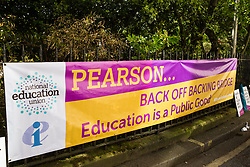London, UK. 4th May, 2018. A banner used by members of the National Education Union (NEU) demonstrating outside the AGM of multinational assessment service Pearson in protest against investment by the corporation in 'low-fee' private schools provider Bridge. Bridge, one of the world's largest education-for-profit companies, aims to extend its influence throughout Africa and Asia.