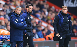 Brighton & Hove Albion manager Chris Hughton (right) and Bournemouth manager Eddie Howe lookn on during the Emirates FA Cup, third round match at the Vitality Stadium, Bournemouth.