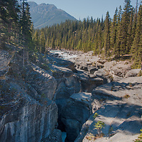 The Mistaya River flows through a slot canyon in Banff National Park, Alberta, Canada.