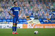 AFC Wimbledon defender Ben Heneghan (22) stood with hands on hips and shouting during the EFL Sky Bet League 1 match between AFC Wimbledon and Hull City at Plough Lane, London, United Kingdom on 27 February 2021.