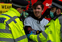 Police made a number of arrests during  anti lockdown protest at Parliament Square in London, Britain, 06 January 2021. photo by Mark anton Smith