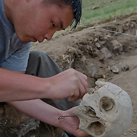 During a Smithsonian Museum expedition, Amgalantugs Tsend, a Mongolian archaeology student, unearths a bronze-age skull at a site above the Delger River near Muren, Mongolia. The skull may be 2700+ years old.