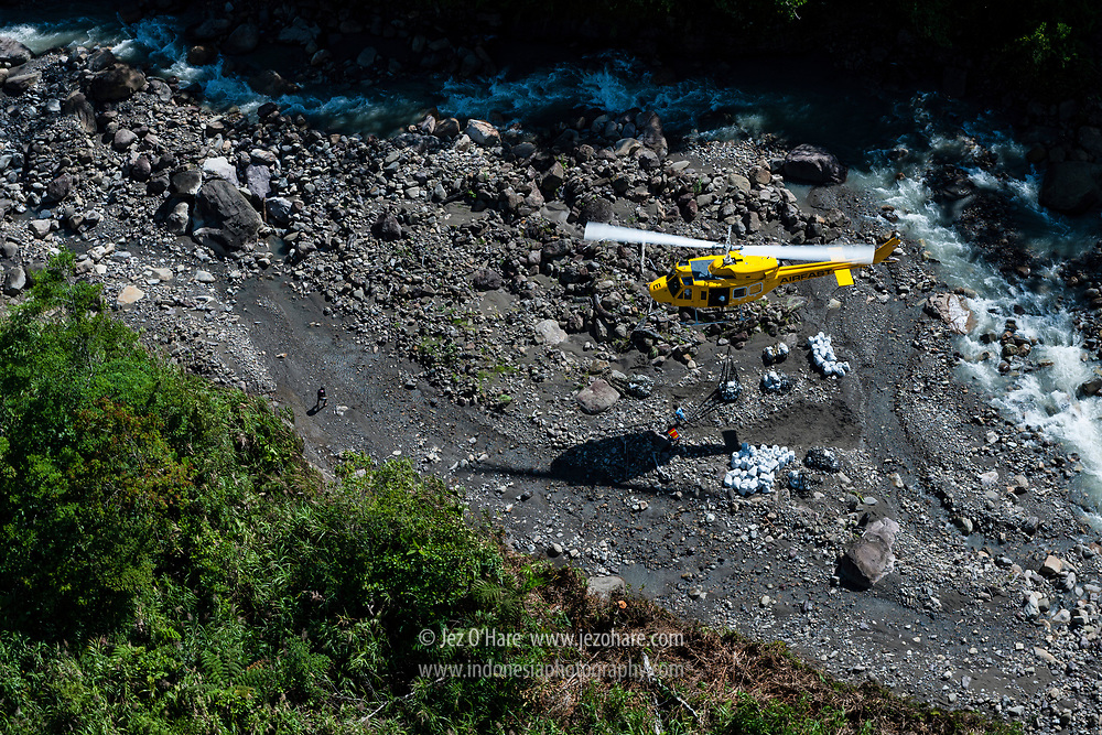 Freeport Bell 212 helicopter sling load operation at Aroanop, Mimika, Papua, Indonesia.