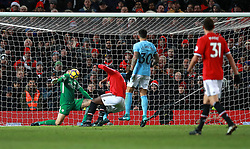 Manchester City goalkeeper Ederson saves a shot on goal by Manchester United's Juan Mata (not pictured)