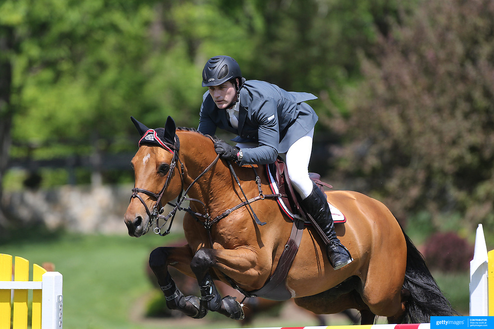 Peter Lutz riding Robin De Ponthual in action during the $100,000 Empire State Grand Prix presented by the Kincade Group during the Old Salem Farm Spring Horse Show, North Salem, New York,  USA. 17th May 2015. Photo Tim Clayton