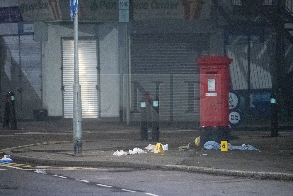 © Licensed to London News Pictures. 11/11/2020. Slough, UK. A post-box is surrounded by medical waste marked out with evidence identification markers outside shops on Stoke Poges Lane. A person was reportedly stabbed in Slough on Tuesday 10/11/2020. A large cordon was put in place by Thames Valley Police centred around shops on Stoke Poges Lane and included a large section of Bradley Road. Photo credit: Peter Manning/LNP
