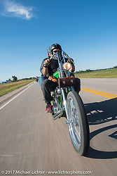 Karen and Bill Stevens of Grand Rapids riding their custom 1968 Yamaha SX-650 chopper south on highway 79 on the Run to the Line for lunch and biker vs Cowboy rodeo games at the Spur Creek Ranch in Newell during the annual Sturgis Black Hills Motorcycle Rally. SD, USA. Wednesday August 9, 2017. Photography ©2017 Michael Lichter.