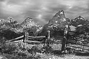 """Fine Art:<br />  """"The lighting in this landscape photograph is of Ansel Adams quality. This is the Teton Mountain range and was taken from the Bar BC Dude Ranch fence. Located in Grand Tetons National Park, it has incredible lighting, and composition. The scene has a kind of spot lighting effect because of the great amount of broken clouds which allowed light to come through spotlighting the scene."""