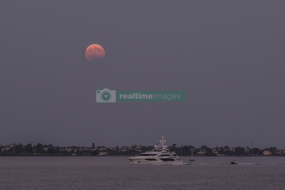 August 7, 2017 - Aulida, Greece - August fullmoon in Aulida (Aulis) at the place where according to Homer 1186 Greek ships started for war against Troy – the start of the Ilias and the place where Iphigene was sacrificed by Agamemnon. In Aulida on August 7 , 2017. The Moon had a partial eclipse, visible from Greece. (Credit Image: © Wassilios Aswestopoulos/NurPhoto via ZUMA Press)