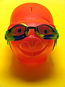 red smiling piggy bank with goggles