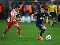 Olympiakos' Hernan Perez and Manchester United's Shinji Kagawa