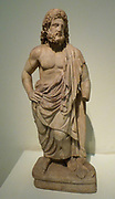 Statuette of the God Asklepios. Pentelic marble. Found in the sanctuary of Asklepios at Epidaurus. According to the inscription on its base, the statuette was dedicated to the god by the Athenian Ploutarchos, priest of Dionysus and Asklepios. Late 3rd to early 4th century AD.