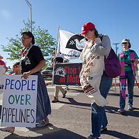 Members of the community march to the McKinley County Courthouse for the Poor Peoples Campaign against uranium mining Monday evening.