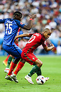 Paul Pogba from France and João Mário from Portugal during the match against France. Portugal won the Euro Cup beating in the final home team France at Saint Denis stadium in Paris, after winning on extra-time by 1-0.